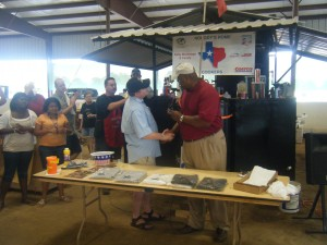 Ret Maj Gen Proctor presents a Challenge Coin to Dan Morrison