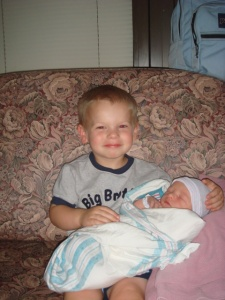 William holding baby brother Andrew