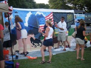 Supporters paint the ThanksUSA Mural for Morale
